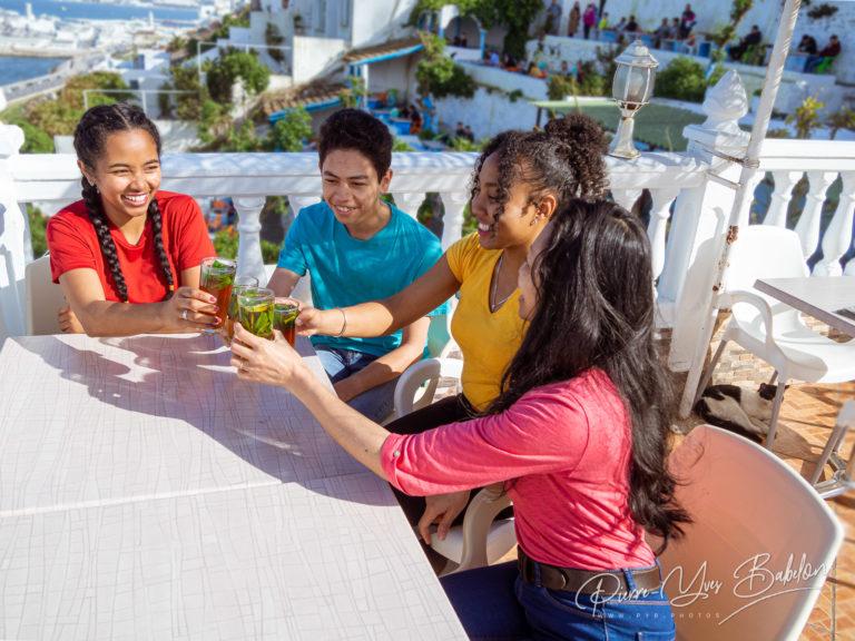 Friends toasted mint tea on terrace
