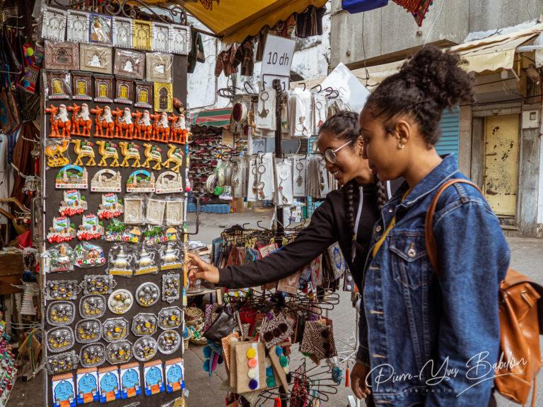 Two mixed race women in a souvenir shop